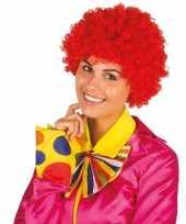 Rode krullen clownspruik verkleed accessoire